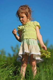 Free Girl Eats Grape Against Blue Sky Stock Photos - 10355673