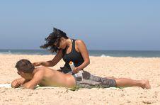 Free Couple Applying Suncream Royalty Free Stock Photo - 10355745