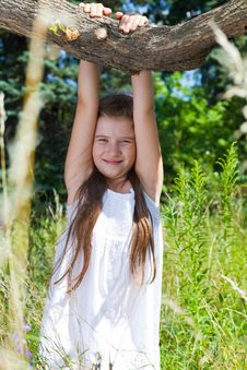 Free Girl  Hangs On A Tree Royalty Free Stock Photography - 10357447