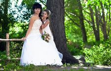 Free Bride Kisses The Daughter Stock Photography - 10357602
