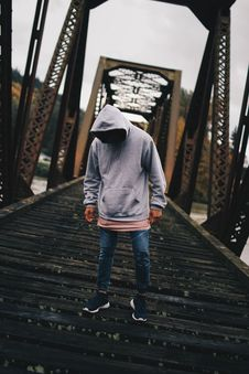 Free Man In Gray Pull-over Hoodie Standing On Train Rail Royalty Free Stock Photo - 103510585