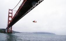 Free Rescue Helicopter Flying Under Golden Gate Bridge Royalty Free Stock Photography - 103510617