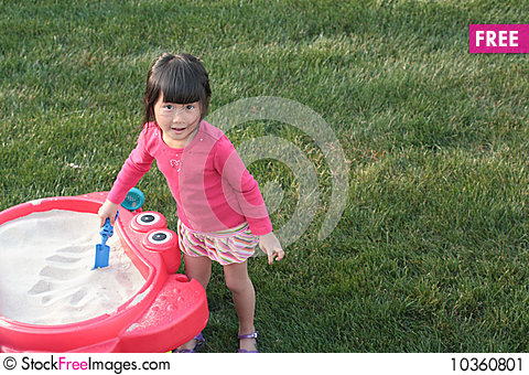 Free Child Playing In Sandbox Stock Image - 10360801