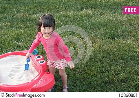 Free Child Playing In Sandbox Stock Image - 10360801