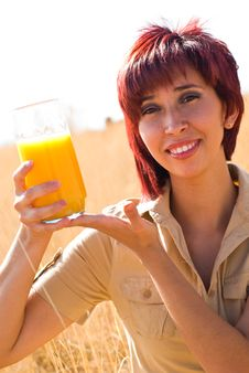 Woman Shows Orange Juice Royalty Free Stock Image