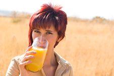 Woman Tasting Orange Juice Stock Photo