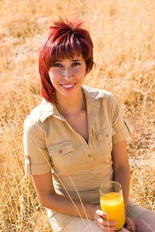 Free Woman Drinking Orange Juice Royalty Free Stock Images - 10360699
