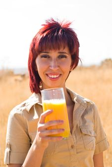 Free Woman Happy Drinking A Orange Juice Stock Photo - 10360860
