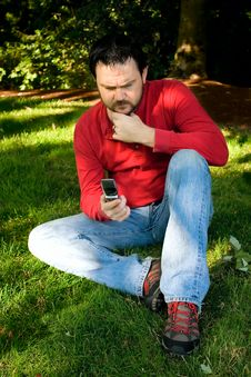 Free Pensive Man With Cellphone In Park Stock Images - 10360884