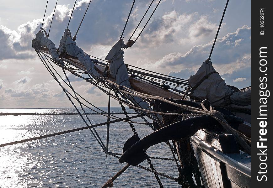 Traditional wood sailboat sailing out