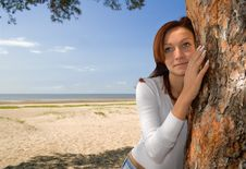 Girl On A Beach In A Shadow Of A Tree-2 Royalty Free Stock Image