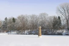 Free Lighthouse On Frozen Pond Stock Image - 1048351