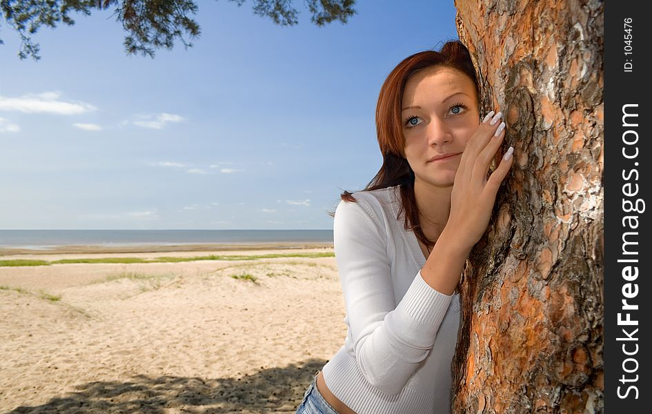 Girl on a beach in a shadow of a tree-2