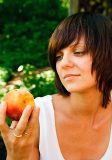 Free Woman And A Peach Stock Photography - 10425122