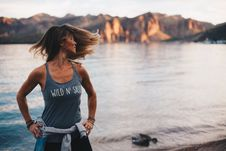 Free Woman Wearing Grey Wild  N Sassy Tank Top Near Body Of Water Royalty Free Stock Photos - 104286898