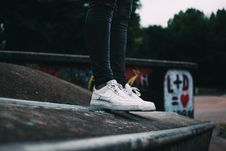 Free Human Standing On The Ground And Wearing White Nike Sneakers Royalty Free Stock Images - 104366679