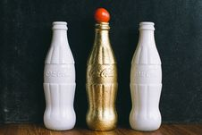 Free Three White And Brass Coca-cola Bottles Stock Image - 104366691