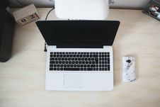 Free Macbook Beside Smartphone On Desk Stock Photos - 104366803