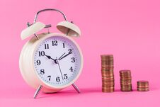 Free Old Clock And Golden Coins On Pink Background Royalty Free Stock Images - 104504999