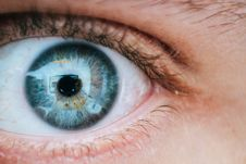 Free Person With Teal And Yellow Left Eye Stock Photo - 104512730