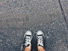 Free Person Wearing Pair Of Black-and-white Converse All Star Low Sneakers Royalty Free Stock Photos - 104512828