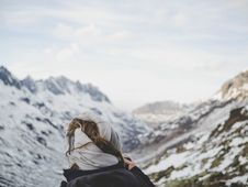 Free Person Wearing Black Jacket In Front Of Mountain Filled With Snow Stock Images - 104569884