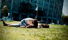 Free Man And Woman Lying On Green Field Royalty Free Stock Photos - 104569938