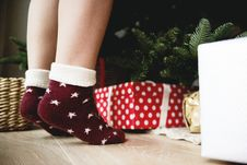 Free Person Wearing Pair Of Maroon Star Printed Socks Royalty Free Stock Photo - 104570075