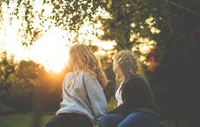 Free Two Women Sitting Near Green Tree During Sunset Royalty Free Stock Photos - 104570078