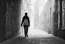 Free Grayscale Photo Of Person Near Brick Wall Royalty Free Stock Photos - 104635698