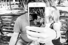 Free Gray Scale Photo Of Man And Woman Taking A Selfie Royalty Free Stock Photography - 104635747