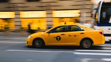 Free Taxi Overtaking Bus Royalty Free Stock Images - 104712319