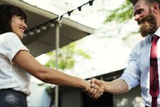 Free Man In White Dress Shirt And Maroon Neck Tie Shaking Hands With Girl In White Dress Stock Images - 104806394