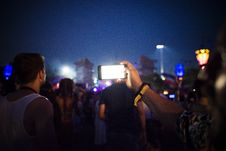 Free Group Of People Using Smartphones During Nighttime Stock Photography - 104886992