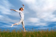 Free Jumping Girl Under Clouds Stock Photography - 1050352
