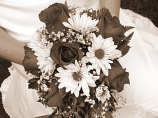 Bride Holding Her Wedding Bouquet Against Her Dress Royalty Free Stock Image