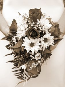 Bride Holding Her Wedding Bouquet Against Her Dress Stock Image
