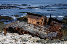 Free Deteriorating Shipwreck On Coast Royalty Free Stock Photo - 1052135