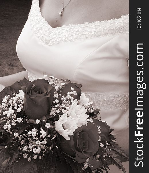 Wedding bouquet and bride s bust in sepia