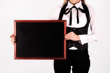 Free Young Elegant Girl Holding Blank Drawing Blackboard In Hands And Space For Text On Board Stock Photography - 105023482