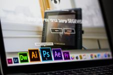 Free Turned On Laptop On Desktop With Hovered Adobe Photoshop Cc Application Stock Photo - 105662270