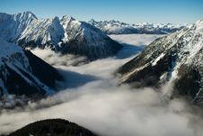 Free Rocky Mountain With Fog In Daytime Photo Stock Photo - 105741730