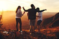 Free Four Person Standing At Top Of Grassy Mountain Royalty Free Stock Photo - 105741735