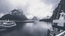 Free Grayscale Photo Of Yachts On Body Of Water Under Cloudy Sky Stock Images - 105741784