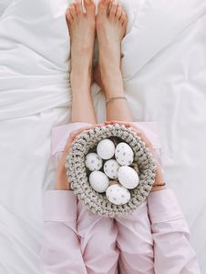 Free Woman Holding Gray Crochet Bowl With Seven Painted Eggs Royalty Free Stock Image - 105741966