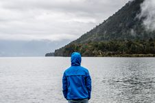 Free Person Wearing Blue Hoodie Near Body Of Water Royalty Free Stock Photography - 105741977