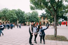 Free Photo Of Two Women Beside Man Taking A Picture Stock Image - 105823711