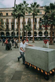Free Man Pushing Gray Cart Stock Photo - 105911900