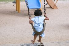 Little Girl Swinging At Park Royalty Free Stock Image