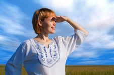 Beauty Girl In Field Under Clouds Stock Photo